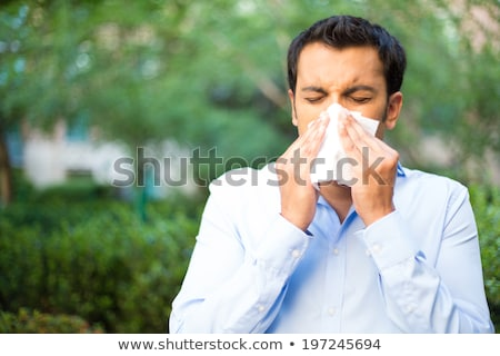 Fiatal ázsiai beteg férfi orrot fúj papír Stock fotó © RAStudio