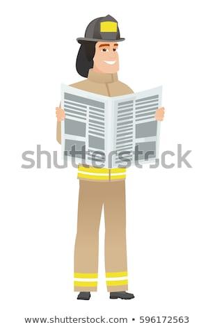 Bombeiro leitura jornal caucasiano jovem em pé Foto stock © RAStudio
