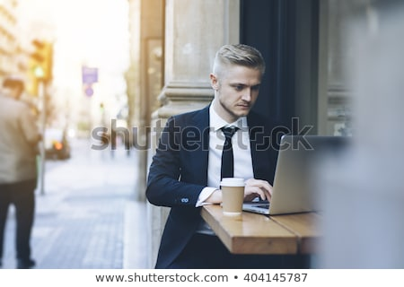 Businessman looking at laptop outside Stock photo © IS2
