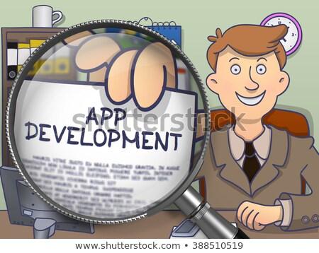 mobile advertising through magnifier doodle design stock photo © tashatuvango