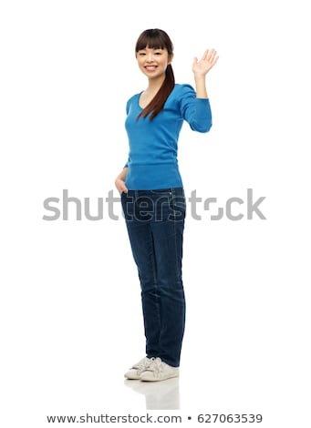 happy smiling young woman waving hand over white Stock photo © dolgachov