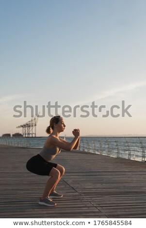 Woman crouching engaging in nature Stock photo © IS2