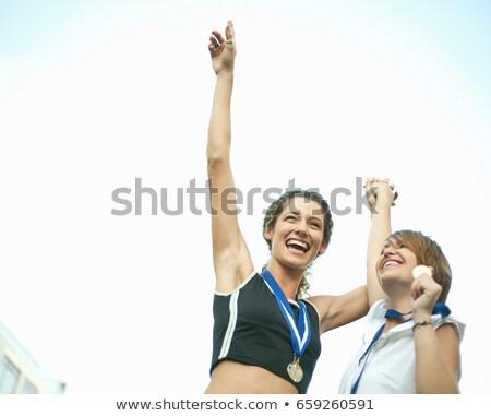 2 female athletes celebrating Stock photo © IS2