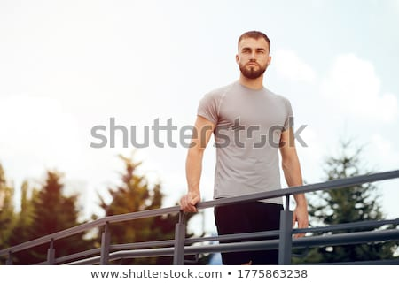 Young man by railing Stock photo © IS2