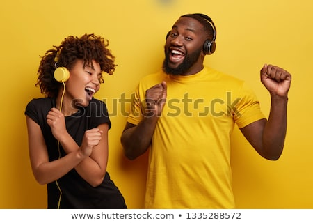Man and woman listening to music Stock photo © IS2