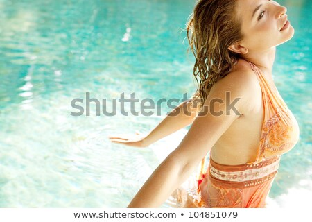 Woman floating on her back in the water Stock photo © IS2