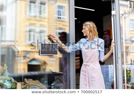 woman owner smiling florist stands holding an open sign small bu stock photo © snowing