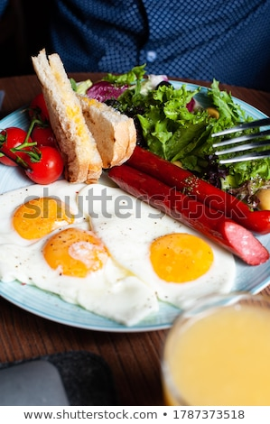 fried eggs with sausage stock photo © digifoodstock