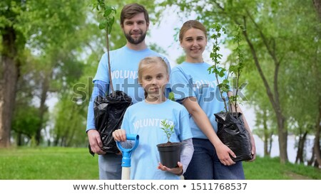 Kid Girl Planting Sapling Stock photo © lenm