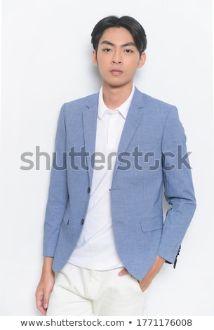 portrait of confident handsome elegant stylish businessman with bow tie holding hand near beard on b stock photo © traimak