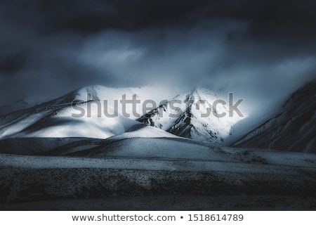 black and white winter snow mountains in dark storm clouds stock photo © bsani