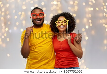 happy couple with party glasses over lights Stock photo © dolgachov