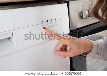 Kobieta przycisk zmywarka widok z boku szczęśliwy Zdjęcia stock © AndreyPopov