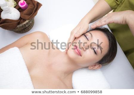 close up of beautiful woman having head massage stock photo © dolgachov