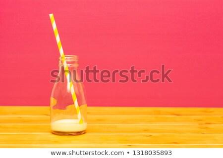 One-third pint glass milk bottle with dregs of banana milkshake Stock photo © sarahdoow