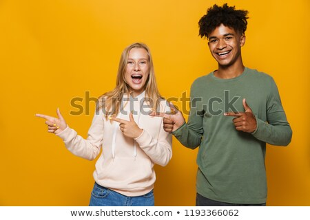 photo of happy friends man and woman 16 18 with dental braces la stock photo © deandrobot