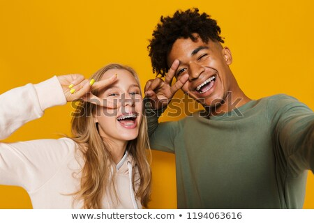 photo closeup of adorable students man and woman 16 18 having fu stock photo © deandrobot