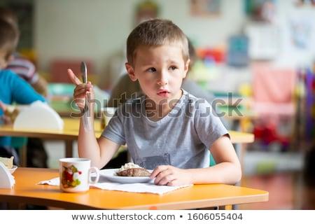 Mooie weinig jongen eten ontbijt keuken Stockfoto © Len44ik