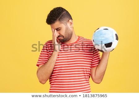 Football Ball Hand Tearing Background Stock photo © Krisdog