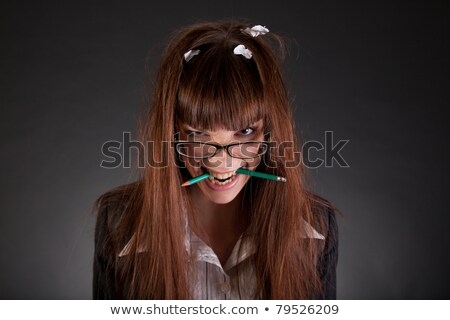Angry businesswoman with broken pencil  Stock photo © Elisanth