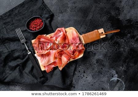 Spanish jamon, prosciutto crudo ham, italian salami Stock photo © karandaev
