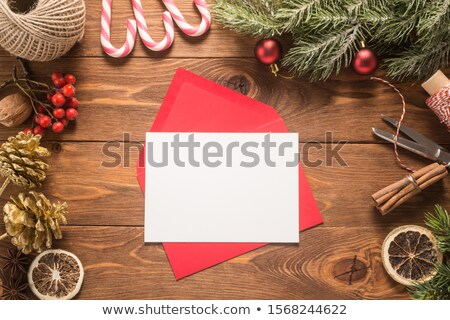 Christmas letter with decoration on the wooden table. Holiday mock up. Scandinavian style. Stock photo © AbstractVanilla