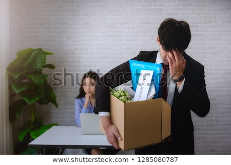 Woman With Her Belonging In Box Stock photo © AndreyPopov