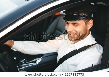 Portret młodych radosny człowiek taksówką kierowcy Zdjęcia stock © deandrobot