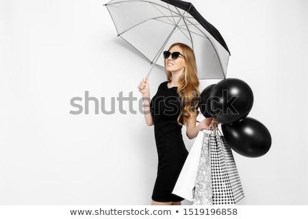 Szczęśliwy kobieta czarna sukienka sprzedaży moda Zdjęcia stock © dolgachov