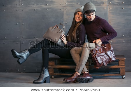 Caucasian couple man and woman in casual clothing sitting on sof Stock photo © deandrobot