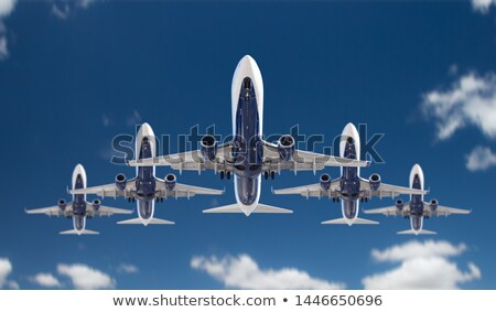 Stockfoto: Bottom View Of Five Passenger Airplanes Flying In Formation In T