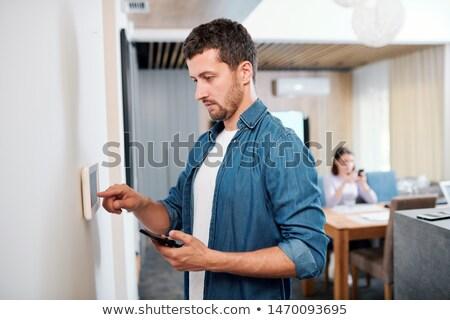 Młodych poważny człowiek nowego smart Zdjęcia stock © pressmaster