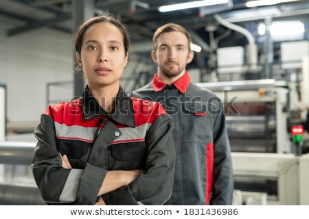 Pretty leader of workteam and two engineers crossing arms by chest Stock photo © pressmaster