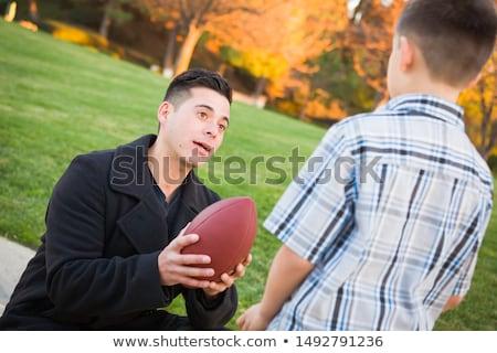 Junge · halten · Fußball · Park · schauen - stock foto © feverpitch