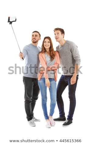 girl taking picture by smartphone on selfie stick Stock photo © dolgachov
