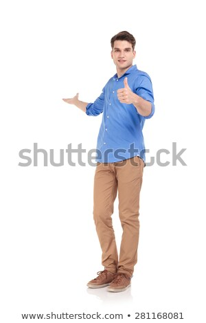 Man in blue shirt showing okay gesture. Stock photo © deandrobot