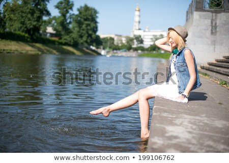 Anonymous woman playing with water on pier Stock photo © dashapetrenko