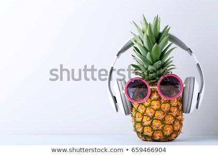 Rijp ananas zonnebril hoofdtelefoon hot zand Stockfoto © karandaev