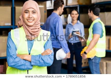 Islam Muslim female warehouse worker portrait with her team Stock photo © vichie81