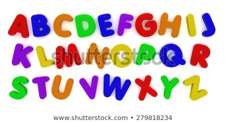 Koelkast magneet alfabet brieven vorm koelkast Stockfoto © creisinger
