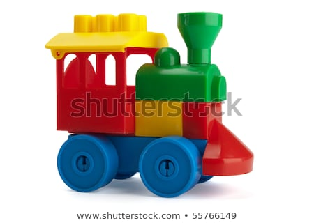 red toy train and yellow toy car on railroad stock photo © paha_l