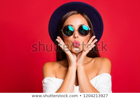 Close up red lips blowing a kiss stock photo © RTimages