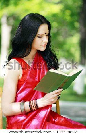 Shot glimlachend lezing boek park Stockfoto © HASLOO