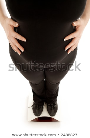 pregnant lady weighing oneself Stock photo © dolgachov