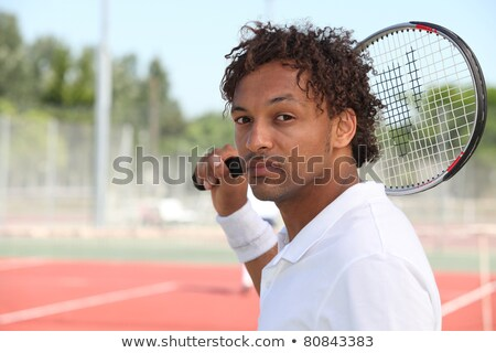 Male tennis player holding racquet over shoulder Stock photo © photography33