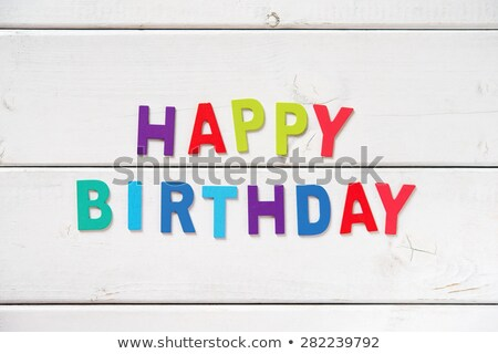 happy birthday in colorful toy letters on wood background stock photo © happydancing
