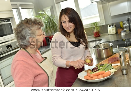 homecare cooking for senior woman Stock photo © photography33