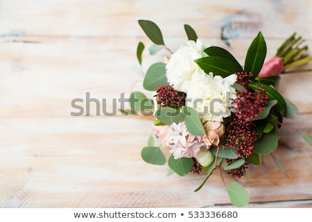 Stock photo: Florist Spraying A Bouquet Of Flowers