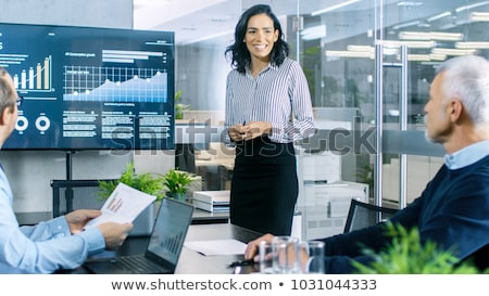 businessman presenting a pie chart stock photo © photography33