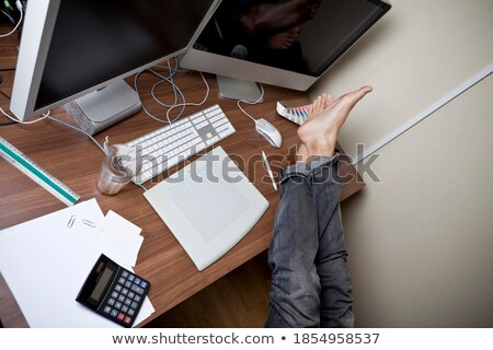 man resting feet on glass desk stock photo © photography33